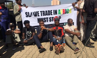 Charlie Boy and co in handcuff as they protest agains slave Trade In Libya