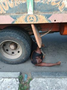Woman Begs Trailer Driver To Crush Her To Death After Her Goods Were Seized By Government Officials In Calabar