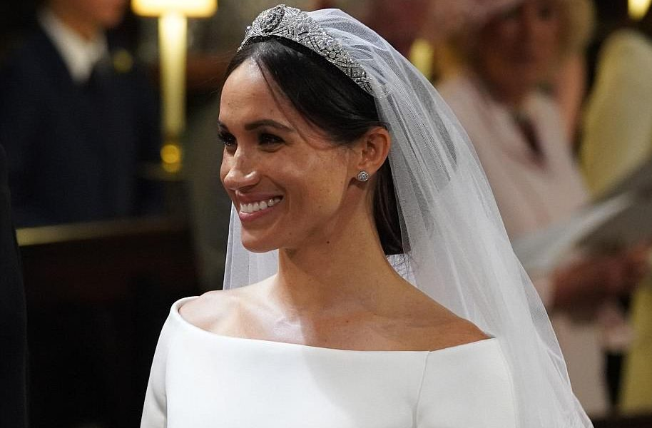 Meghan's sparkling tiara is Queen Mary's Diamond Bandeau, which has been loaned to her by Harry's grandmother the Queen.