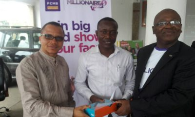 From left: Manager, Challenge Branch (Ibadan) of First City Monument Bank (FCMB), Mr. Kamoru Omotosho; one of the winners of a television set at the first draws of the FCMB Millionaire Promo Season 5 in the South-west Region, Engr. Murtala Oseni; Regional Head, South-west of the Bank, Mr. Adelaja Adeleye and Regional Service Head, Mr. Oyetola Oyewusi, during the promo draw ceremony in Ibadan, Oyo State, on May 23, 2018.