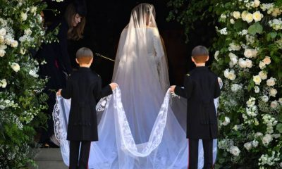 The bride enters St George's Chapel flanked by 10 bridesmaids and page boys, including Prince George and Princess Charlotte.