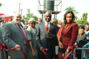L-R Mission Director, United States Agency International Development(USAID), Mr. Stephen Haykin; Eze of Amiyu Uhu Community, His Royal Majesty, Ifeanyi Udeagha; Deputy Governor, Abia State, Rt. Hon. Ude Okochukwu; Commissioner for Public Utilities and Water Resources, Barrister Chidebere Nwoke and Public Affairs and Communication Manager, Coca-Cola Nigeria, Mrs. Nwamaka Onyemelukwe during the commissioning of Water and Sanitation facilities in Amiyi Uhu community in Abia state recently.
