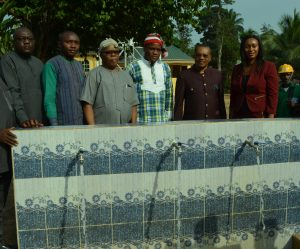 Country Program Director, Partners for Development (PfD), Mr. Ediri Iruaga, Project Coordinator, Abia state Rural Water and Sanitation Project, Engr. Ugo Oku; Eze of Amiyu Uhu Community, His Royal Majesty, Ifeanyi Udeagha; Public Affairs Analyst, West Africa Business Unit, Coca-Cola, Emeka Mba; Commissioner for Public Utilities and Water Resources, Barrister Chidebere Nwoke and Public Affairs and Communication Manager, Coca-Cola Nigeria, Mrs. Nwamaka Onyemelukwe during the commissioning of water facilities in Amiyi Uhu community in Abia state.
