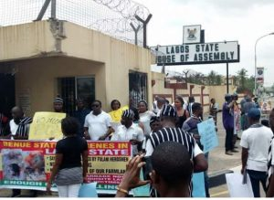 Photos: Governor Ambode's Supporters Storm Lagos Assembly To Protest Proposed Impeach Him