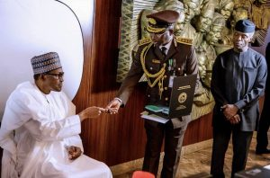 Photo Speaks: Buhari Gets Newly Launched 10-Year International Passport