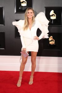 Super Model Heidi Klum was angelic in a white Stephane Rolland look with wild flounces on the shoulders that looked like wings