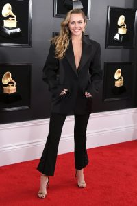 Miley Cyrus made it clear that suits can be sexy wearing a well-tailored black Mugler look without a shirt underneath