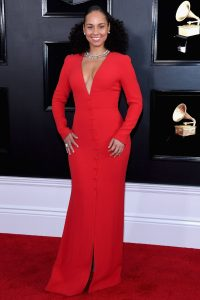 Host of the night Alicia Keys kept it simple in a red dress adorned with button at the center