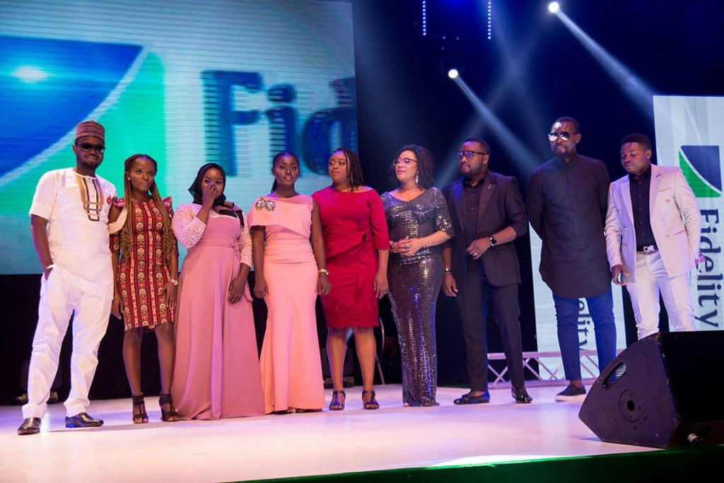 Head, CSR& Sustainability, Fidelity Bank PLC, Chris Nnakwe (3rd right) and CEO, Gazelle Academy, Muna Onuzor, consultant to Fidelity on CSR with YEA beneficiaries