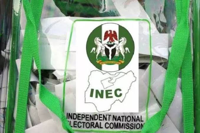 INEC crest on a transparent ballot box with election materials in it