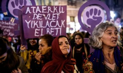 Protesters hold a banner reading 'Women resist male domination' as they march in Istanbul in 2016, when a similar bill was proposed