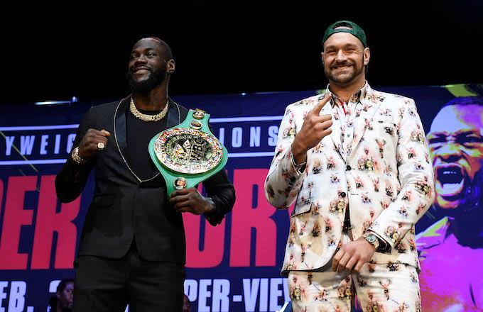 L-R - Deontay Wilder and Tyson Fury during press conference in Los Angeles on Tuesday