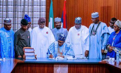 buhari-signing-bill