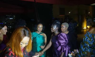 Lupita Nyong'o (L) and Chimamanda Adichie greet guests at an event in Lagos on Saturday, February 22, 2020.