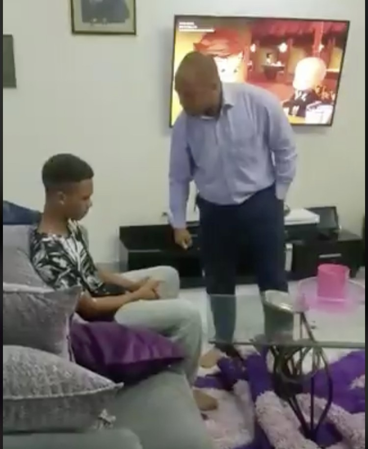 Viral video of father scolding and beating son over failing in school