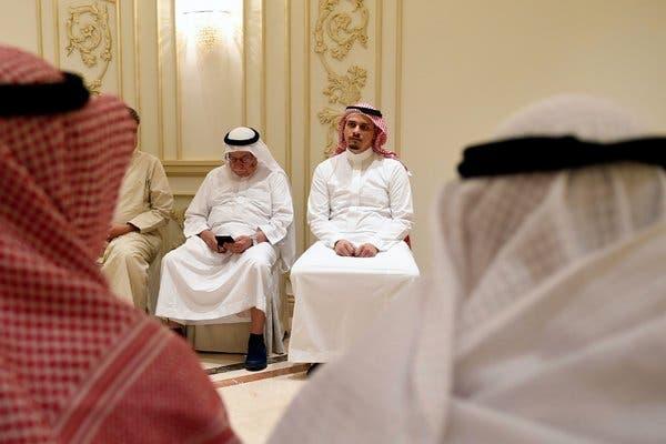 Salah Khashoggi, center, a son of the Saudi dissident journalist Jamal Khashoggi, and his relatives received mourners at a hall in Saudi Arabia last year.Credit...Amer Hilabi/Agence France-Presse — Getty Images