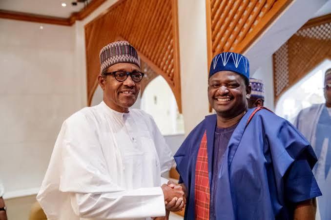 L-R: President Buhari and Femi Adesina