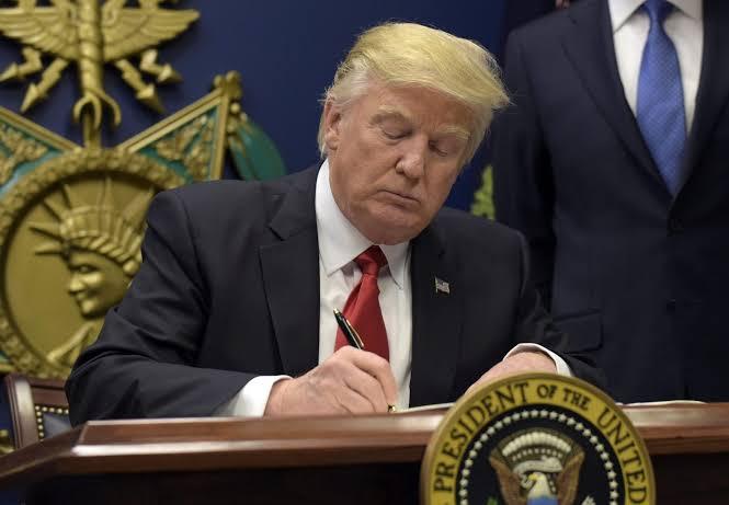 Donald Trump bans work visa