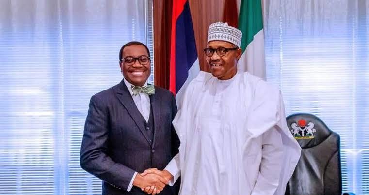 Dr Adewumi Adesina and President Buhari