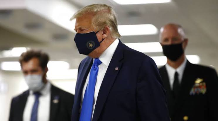 President Donald Trump wears face mask for the first time in public