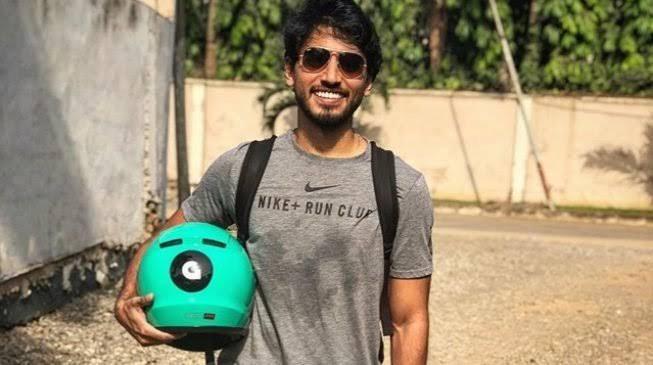 Late Fahim Saleh holding a Gokada helmet